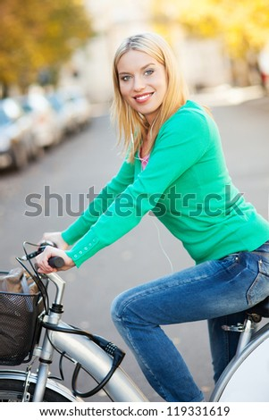 Young woman on bike - stock photo