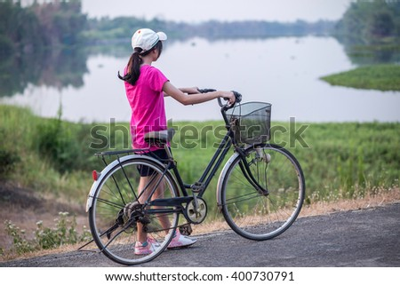Young woman on bike  on road