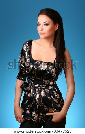 young woman on blue background - stock photo