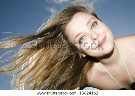 Young Woman On Blue Sky Background