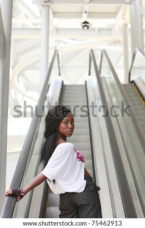 Young woman on elevator looking back - stock photo