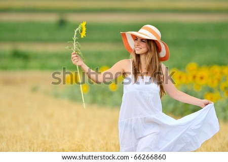 young woman on field in summer - stock photo