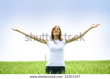Young woman on green meadow - stock photo