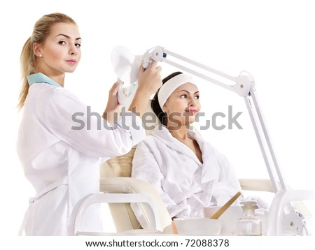 Young woman on massage table in beauty spa. Series. - stock photo
