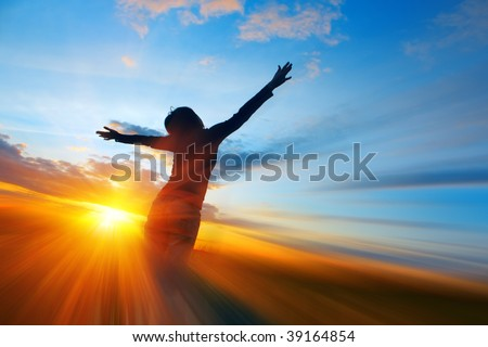 Young woman on meadow under sunset light with abstract motion - stock photo