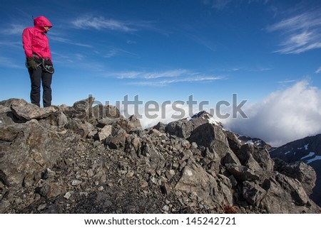 Young woman on mountain ridge