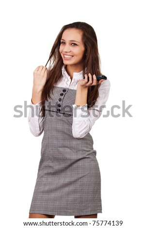 Young woman on phone on white background - stock photo
