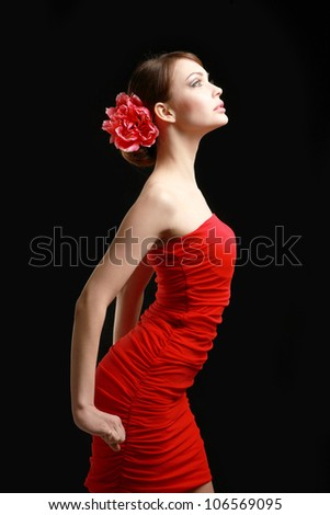 Young woman on red dress, isolated on black background