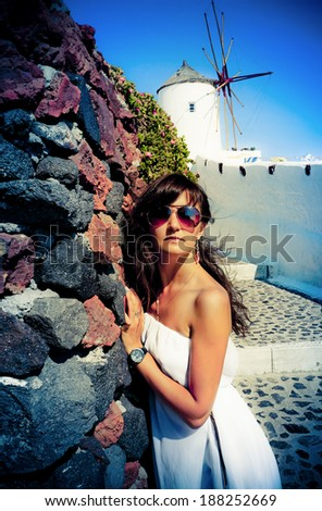 Young woman on  Santorini Oia town  - stock photo