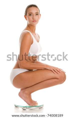 Young woman on scale - stock photo
