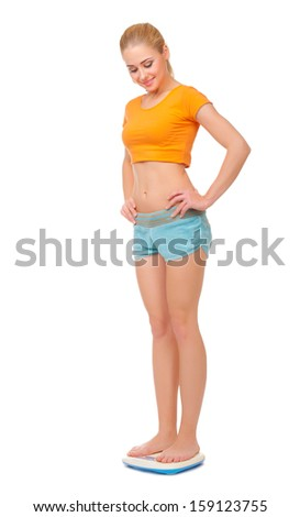 Young woman on scales isolated - stock photo