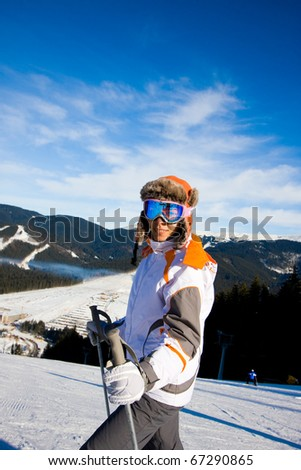 Young woman on ski vacation - stock photo