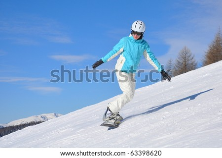 Young woman on snowboard - stock photo