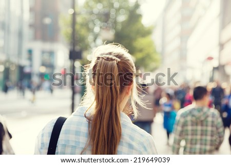 young woman on street of London - stock photo