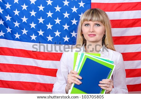 Young woman on the background of the flag of America - stock photo