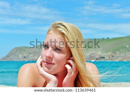 young woman on the beach - stock photo