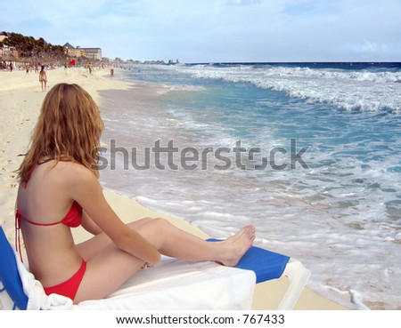 Young woman on the beach at Cancun - stock photo