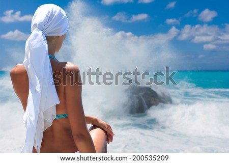 Young woman on the beach in Greece - stock photo