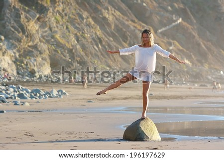 young woman on the beach in summer sunny day - stock photo