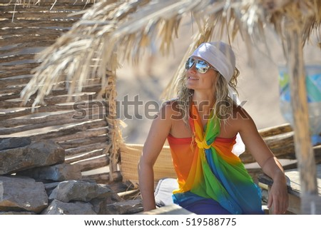 young woman on the beach in summer sunny day