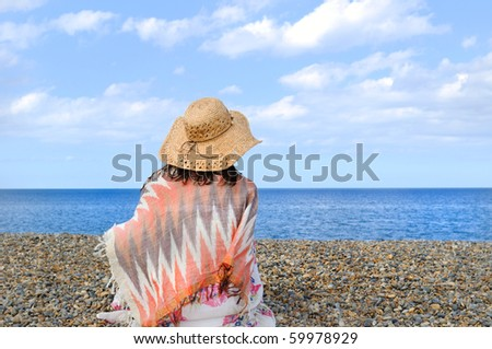 Young woman on the beach. North sea. - stock photo