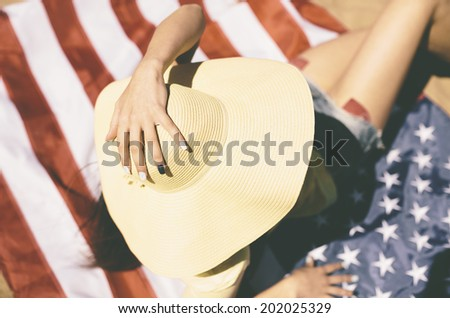 young woman on the beach, selective focus - stock photo
