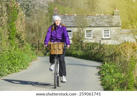 Young woman on the bicycle - stock photo