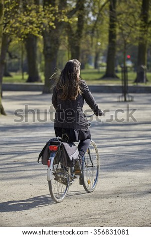 Young woman on the bicycle in the park