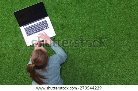young woman on the grass in park or garden - stock photo