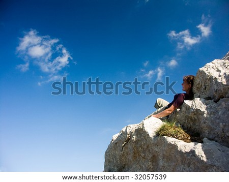 young woman on the mountain. Relax and blue sky.