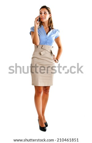 Young woman on the phone full length - stock photo