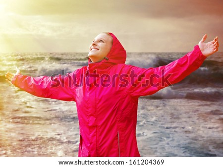 Young woman on the sea enjoying her life - stock photo