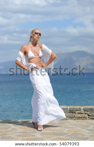 Young woman on the seacoast - stock photo