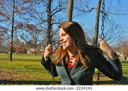 Young woman on the swings
