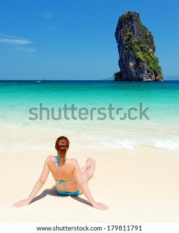 Young woman on the tropical beach. - stock photo