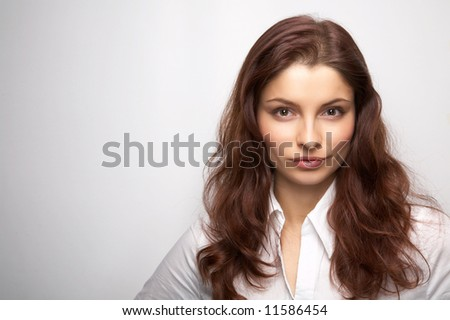 Young woman on the white background - stock photo