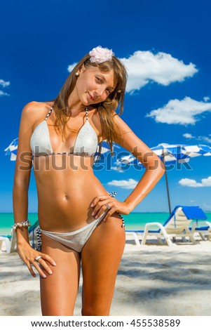 Young woman on the white sand  beach at tropical resort