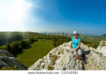 young woman on top of the rock