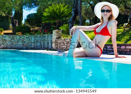 Young woman on tropical beach. - stock photo