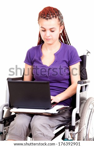 Young woman on wheelchair - stock photo