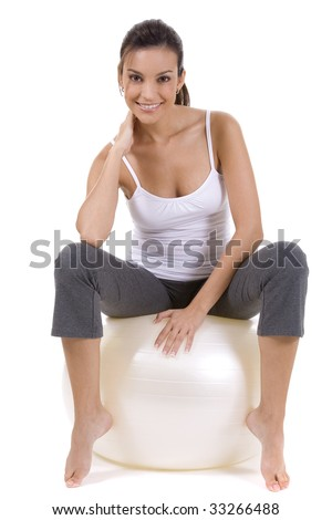 Young woman on white background in a fitness pose - stock photo