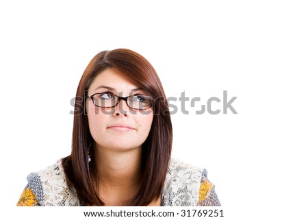 Young Woman on white wearing glasses looking to right and up.