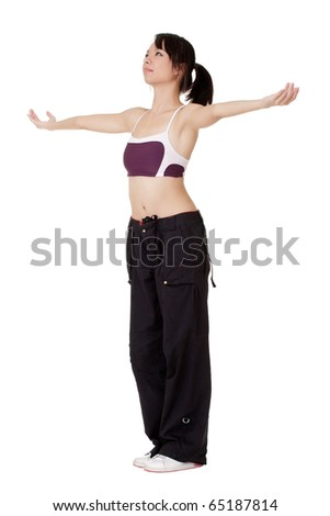 Young woman open arms and feel free, isolated over white. - stock photo