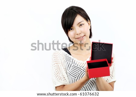 Young woman opening a box
