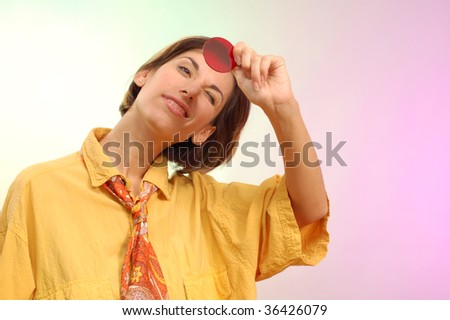 young woman optimist see through rose-coloured glass - stock photo