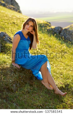 young woman outdoor at sunset - stock photo