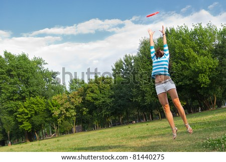 Young woman outdoor jumping - stock photo