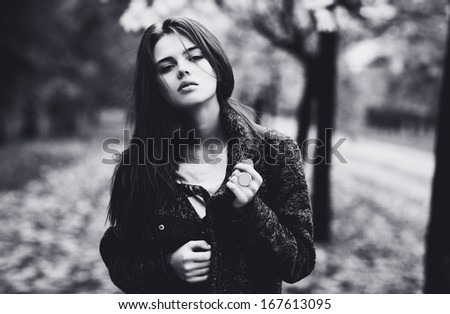 Young woman outdoors autumn portrait. Black and white colors.