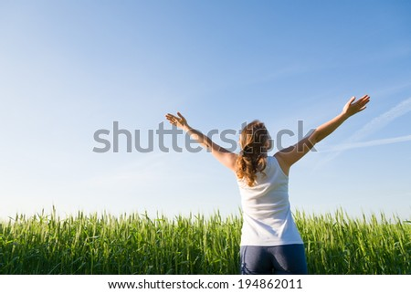young woman outdoors in green summer field