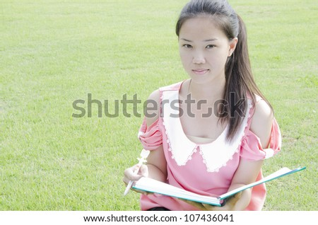 Young woman outdoors portrait - stock photo